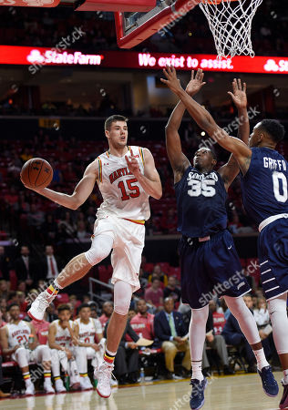 Michal Cekovsky, Quadir Welton, Nick Griffin Maryland forward Michal Cekovsky (15) looks to pass the ball against St. Peter's center Quadir Welton (35) and guard Nick Griffin (0) during the second half of an NCAA college basketball game, in College Park, Md. Maryland won 66-56