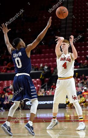 Kevin Huerter, Nick Griffin Maryland guard Kevin Huerter (4) passes the ball against St. Peter's guard Nick Griffin (0) during the second half of an NCAA college basketball game, in College Park, Md. Maryland won 66-56