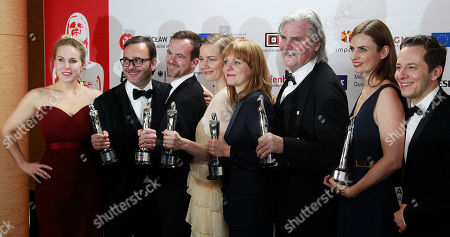 "The creators of the European Film of the Year ""Toni Erdmann,"" from left right : actress Hadewych Minis, producers: Michel Merkt, Jonas Dornbach, actress Sandra Hueller, director Maren Ade, actor Peter Simonischek, producer Janine Jackowski and actor Trystan Puetter pose after the 29th European Film Awards ceremony in Wroclaw, Poland,. The awards are presented annually by the European Film Academy to recognize excellence in European cinema"