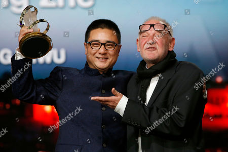 """Zang Qiwu, Bela Tarr Chinese Director Zang Qiwu, left, poses for photographers after winning the Golden Star prize for the film """"The Donor"""" with Jury president Bela Tarr during the closing ceremony of the the 16th Marrakech International Film Festival in Marrakech, Morocco"""