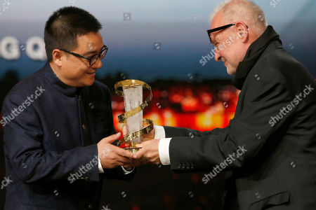 """Zang Qiwu, Bela Tarr Jury president Bela Tarr, right, gives an award to Chinese Director Zang Qiwu after winning the Golden Star prize for the film """"The Donor"""" during the closing ceremony of the the 16th Marrakech International Film Festival in Marrakech, Morocco"""