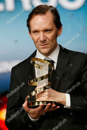 """Austrian film director Rainer Frimmel poses for photographers after winning the Jury prize for the film """" Mister Universo """" during the closing ceremony of the the 16th Marrakech International Film Festival in Marrakech, Morocco"""