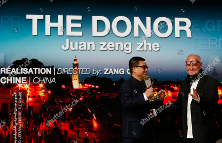 """Zang Qiwu, Bela Tarr Chinese Director Zang Qiwu and Jury president Bela Tarr, right, pose for photographers after winning the Golden Star prize for the film """"The Donor"""" during the closing ceremony of the the 16th Marrakech International Film Festival in Marrakech, Morocco"""