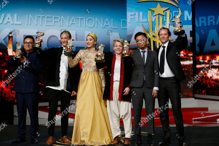 """Blaer Hinriksson, Zang Qiwu, Baldur Einarsson Chinese Director Zang Qiwu win the Golden Star prize for the film """"The Donor,"""" Blaer Hinriksson and Baldur Einarsson, 3rd left, wind the Best performance by an actor prize for the film """" Heartstone """", Fereshteh Hosseini, wind the Best performance by an actress prize for the film """" Parting """" Producer Wang Zijian wind the Directing prize for the film """" Nife in the clear water """" and Austrian film director Rainer Frimmel wind the Jury prize for the film """" Mister Universo """" pose for photographers during the closing ceremony of the the 16th Marrakech International Film Festival in Marrakech, Morocco"""
