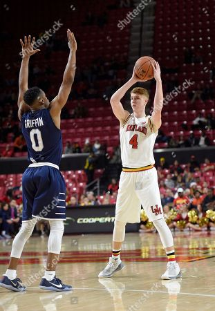 Maryland guard Kevin Huerter (4) looks to pass against St. Peter's guard Nick Griffin (0) during the second half of an NCAA college basketball game, in College Park, Md. Maryland won 66-56