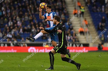 Gerard Moreno of RCD Espanyol and Fernando Amorebieta of Sporting de Gijon jumping during the Liga match between RCD Espanyol and Sporting de Gijon played at the RCD Espanyol Stadium, Barcelona, Spain on 11th December 2016