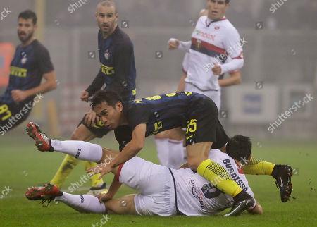 Inter Milan's Yuto Nagatomo and Genoa's Nicolas Burdisso vie for the ball during a serie A soccer match between Inter Milan and Genoa, at the San Siro stadium in Milan, Italy