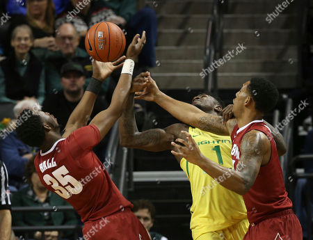 Donta Hall, ordan Bell, Shannon Hale Alabama's Donta Hall, left, and Shannon Hale, right, battle Oregon's Jordan Bell, center, for the ball during the second half of an NCAA college basketball game, in Eugene, Ore