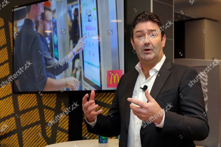 McDonald's CEO Steve Easterbrook speaks during a presentation at a McDonald's restaurant in New York's Tribeca neighborhood