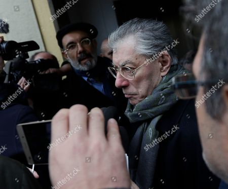 Northern League founder Umberto Bossi leaves after a press conference by current leader Matteo Salvini in Milan, Italy, . The Northern League did not take part in the talks with Premier-designate Paolo Gentiloni, as they are demanding for immediate elections