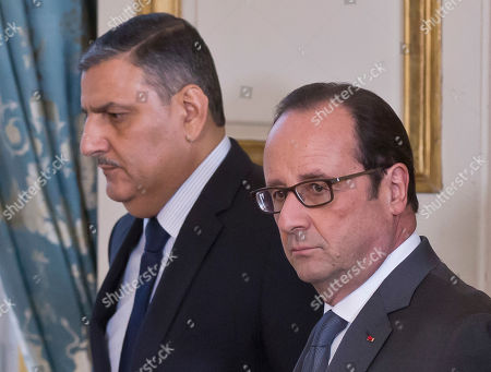 Chief Negotiator for the Syrian Opposition Riyad Hijab, left, and French President Francois Hollande arrive for a joint media conference at the Elysee Palace in Paris, . France's president Francois Hollande pleaded for a humanitarian corridor to allow civilians to flee and get access to food and medical aid, as the Syrian government forces said they gained control of 98 percent of eastern Aleppo, previously a rebel-held enclave