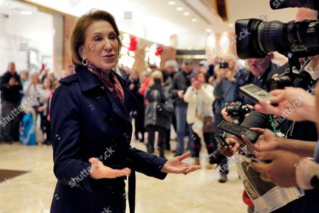 Carly Fiorina stops to talk with the press in the lobby of Trump Tower, after her meeting with President-elect Donald Trump, in New York