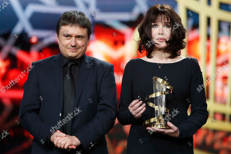 Cristian Mungiu, Isabelle Adjani Director Cristian Mungiu, left, and French actress Isabelle Adjani pose for photographers during a tribute to her contribution to acting, during the 16th Marrakech International Film Festival in Marrakech, Morocco