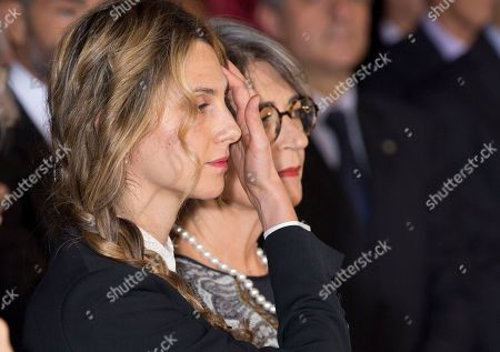 Anna Finocchiaro, right, Minister of Relations with the Parliament, is flanked by Marianna Madia, Minister of Public Administration and Simplification, prior to the swearing-in ceremony for Italy's new government at Rome's Quirinale Presidential Palace,. Paolo Gentiloni, a Democrat serving as foreign minister, formed Italy's new government Monday, keeping several key ministers from the coalition of Matteo Renzi, who resigned last week