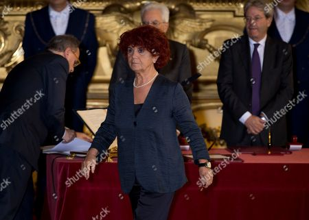 Italian Education Minister Valeria Fedeli walks away after taking his oath of office for Italy new's government, at Rome's Quirinale Presidential Palace, . Paolo Gentiloni, a Democrat serving as foreign minister, formed Italy's new government Monday, keeping several key ministers from the coalition of Matteo Renzi, who resigned last week