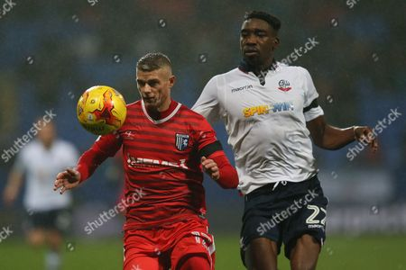 Paul Konchesky of Gillingham and Sammy Ameobi of Bolton Wanderers during the Sky Bet League One match between Bolton Wanderers and Gillingham played at the Macron Stadium, Bolton on 12th December 2016