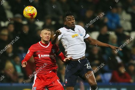 Sammy Ameobi of Bolton Wanderers and Paul Konchesky of Gillingham during the Sky Bet League One match between Bolton Wanderers and Gillingham played at the Macron Stadium, Bolton on 12th December 2016