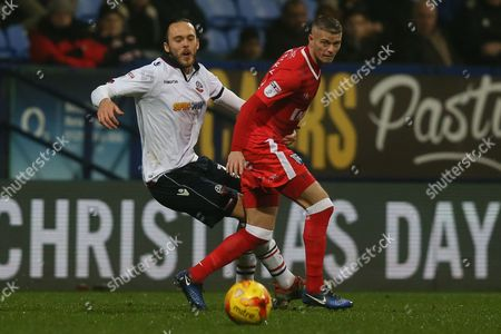 Tom Thorpe of Bolton Wanderers and Paul Konchesky of Gillingham during the Sky Bet League One match between Bolton Wanderers and Gillingham played at the Macron Stadium, Bolton on 12th December 2016