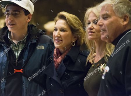 Carly Fiorina poses for a photo in the lobby of Trump Tower following her meeting with President-elect Donald Trump