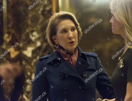 Carly Fiorina (L) and Kellyanne Conway (R) say goodby in the lobby of Trump Tower following Ms. Fiorina's meeting with President-elect Donald Trump