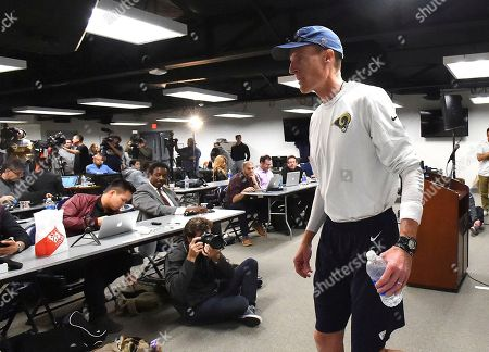 Los Angeles Rams interim head coach John Fassel leaves after addressing the media at the team's training facility at California Lutheran University in Thousand Oaks, Calif., . Fassel, the team's special teams coach, will replace Jeff Fisher on an interim basis for the final three games of this season. The team's coach since 2012, Fisher compiled a 31-45-1 record with the Rams and oversaw the move from St. Louis to Los Angeles this past offseason