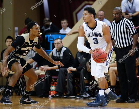In this Nov. 17, 2016 photo, Western Michigan's Joeviair Kennedy (2), left, guards Villanova's Josh Hart (3) in Charleston, S.C. Kennedy was arraigned in a Kalamazoo, Mich., County court in the fatal shooting of fellow student Jacob Jones in an off-campus apartment. Prosecutors have filed murder and armed robbery charges