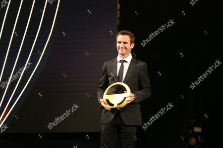 WEC Championship driver, Romain Dumas poses with wheel of gold