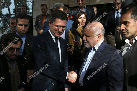Bijan Zanganeh, Alexander Novak Iranian Oil Minister Bijan Zanganeh, right, and Russian Energy Minister Alexander Novak shake hands at the conclusion of their meeting, in Tehran, Iran