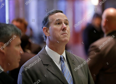 Former Pennsylvanian Sen. Rick Santorum waits for an elevator in Trump Tower in New York
