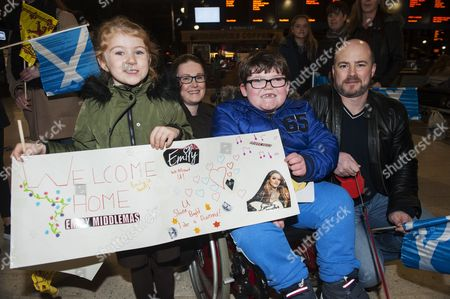 Fans (L-R) Cara Mullen, 5, from Ruchazie, Lisa, 36, Arran, 7 and Ian Hunter. The Hunter family are from the Rohhad Association that Emily Middlemas is an ambassador for.