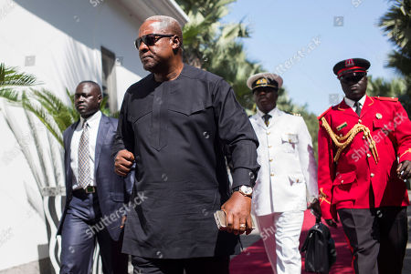 Ghana President, John Dramani Mahama, on arrival for talks with President Yahya Jammeh, in Banjul, Gambia, . Several West African leaders have arrived in Gambia to urge the country's leader to respect elections that voted him out of power after 22 years. President Yahya Jammeh initially conceded defeat but late last week announced he was rejecting the Dec. 1 vote results. He alleges voting irregularities