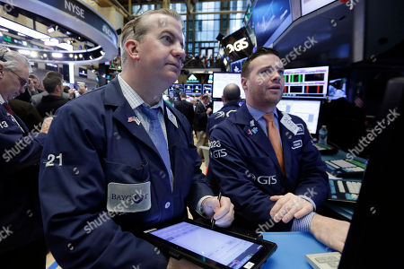 James Doherty, Frank Masiello Trader James Doherty, left, and specialist Frank Masiello work on the floor of the New York Stock Exchange, . Stocks are opening slightly higher on Wall Street, led by gains in safe-play stocks like phone companies and utilities