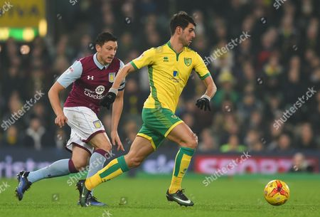 Tommy Elphick of Aston Villa  and Nelson Oliveira of Norwich City during the Sky Bet Championship match between Norwich City and Aston Villa played at Carrow Road, Norwich on 13th December 2016