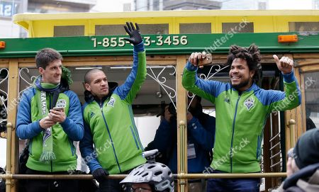 Stock Picture of Alvaro Fernandez, Osvaldo Alonso, Roman Torres Seattle Sounders Alvaro Fernandez, left, Osvaldo Alonso and Roman Torres waves to fans before a march and rally celebrating the team's MLS Cup Championship, in Seattle. Seattle beat Toronto FC 5-4 in a penalty kick shootout Saturday to win their first MLS championship