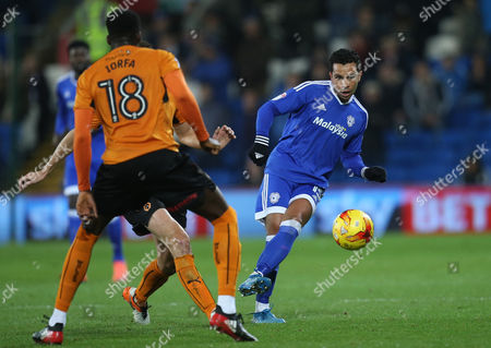 Kieran Richardson of Cardiff City plays the ball past Dominic Iorfa of Wolverhampton Wanderers