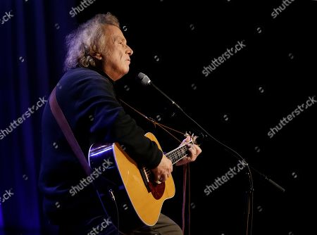 Don McLean performs during a taping for Dolly Parton's Smoky Mountain Rise Telethon, in Nashville, Tenn. Parton has lined up an all-star list of performers for a three-hour telethon to raise money for thousands of people whose homes were damaged or destroyed in Tennessee wildfires