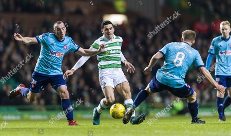 Darian MacKinnon & Greg Docherty of Hamilton Academical challenge Tom Rogic of Celtic during the SPFL Ladbrokes Premiership match between Celtic & Hamilton Academical at Celtic Park, Glasgow on 13th December