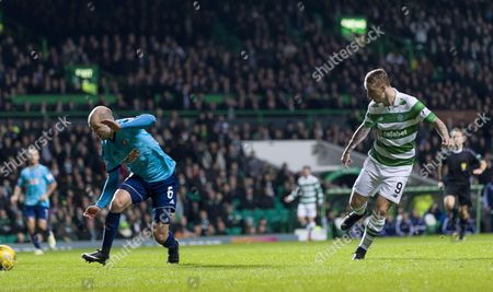 Leigh Griffiths of Celtic shoots past Grant Gillespie of Hamilton Academical to score their first goal during the SPFL Ladbrokes Premiership match between Celtic & Hamilton Academical at Celtic Park, Glasgow on 13th December