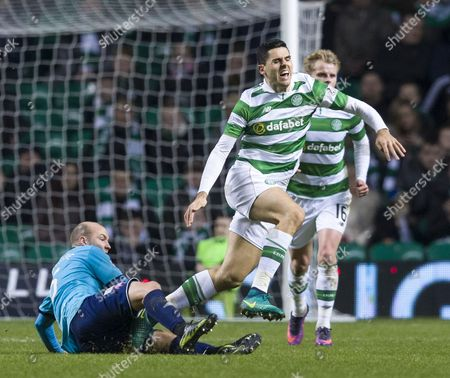 Tom Rogic of Celtic fouled by Grant Gillespie of Hamilton Academical during the SPFL Ladbrokes Premiership match between Celtic & Hamilton Academical at Celtic Park, Glasgow on 13th December