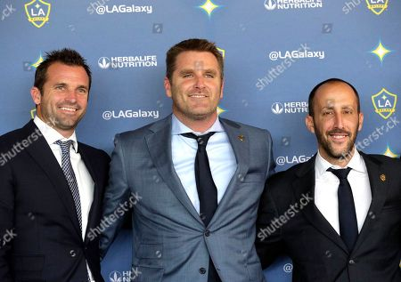 Curt Onalfo, Peter Vagenas Los Angeles Galaxy, President Chris Klein, left, Head Coach Curt Onalfo, middle, and General Manager, Peter Vagenas pose for photos as Onalfo is introduced as the team's new head coach at news conference in Carson, Calif., . Onalfo replaces Bruce Arena, who returned to the U.S. national team after guiding the LA Galaxy to three MLS Cup titles.The 47-year-old former LA Galaxy player led the LA Galaxy II to a 41-20-25 record and three consecutive playoff berths, including last year's USL Western Conference championship. Onalfo has won an MLS Cup both as a player and a coach