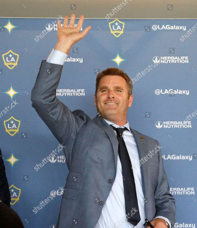 Stock Image of Curt Onalfo smiles as he is introduced as the new head coach of the Los Angeles Galaxy soccer team at news conference in Carson, Calif., . Onalfo replaces Bruce Arena, who returned to the U.S. national team after guiding the Los Angeles Galaxy to three MLS Cup titles