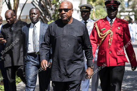 Ghana President, John Dramani Mahama, walks on arrival for talks with President Yahya Jammeh, in Banjul, Gambia, . Gambia's ruling party pressed for fresh elections, as West African regional mediators intervened Tuesday to try to resolve a political crisis in the tiny West African country that voted its leader of 22 years from power