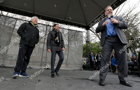 Seattle Sounders general manager Garth Lagerwey, right, speaks as owners Joe Roth, left, and Adrian Hanauer, center, look on during a celebration rally at the Seattle Center, in Seattle. The Sounders beat Toronto FC on Dec. 10, 2016 to win the MLS soccer championship