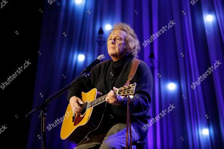 Don McLean performs during a taping of Dolly Parton's Smoky Mountain Rise Telethon, in Nashville, Tenn. Parton has lined up an all-star list of performers for a three-hour telethon to raise money for thousands of people whose homes were damaged or destroyed in Tennessee wildfires