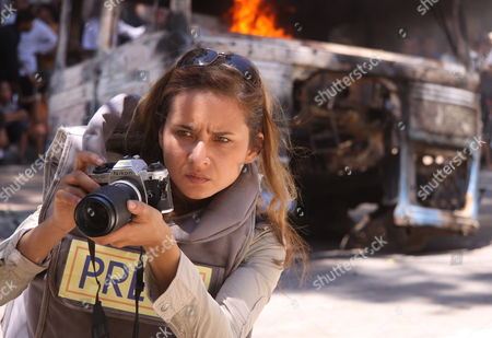 A Picture Dated 29 June 2009 Shows Egyptian Actress Nelly Karim Performing On the Set of Tv Series 'Hudo' Nisbi' ('relative Calmness') in Damascus Syria the Tv Show is Directed by the Tunisian Director Shawqi Al-majiri Talking About Arab and Foreign Journalists in Iraq 'Hudo' Nisbi' Will Be On Screen During the Month of Ramadan
