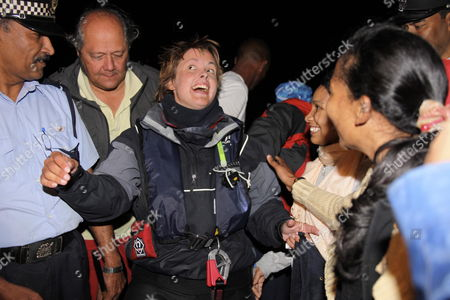 British Rower Sarah Outen is Greeted by Islanders As She Arrives in On the Island of Mauritius in the Indian Ocean On 03 July 2009 Sarah Outen Set Off 124 Days Ago From Fremantle Australia On April First 2009 in an Attempt to Be the First Woman to Row Solo Across the Indian Ocean Sarah Had a Dramatic Landing When She Was Rolled Over by Huge Waves Onto the Corral Reef On the Southern Part of the Island Stuck On the Reef She Fired Flares to Help Guide the Rescue Boat Which Found Her and Led Her Through the Reef to Awaiting Family and Friends