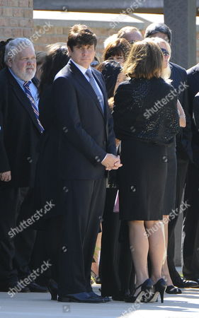 Indicted Former Illinois Governor Rod Blagojevich Stands with Mourners Outside the Church As He Leaves Funeral Services For Christopher Kelly Blagojevich's Former Adviser and Fundraiser in Western Springs Illinois Usa 16 September 2009 Kelly Who Pled Guilty to Federal Charges not Related to Blagojevich and Was to Report to Prison 18 September Committed Suicide 12 September Reportedly Under Pressure From Authorities to Testify Against Blagojevich