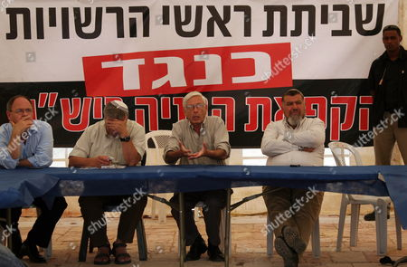 Right-wing Likud Lawmaker Benny Begin the Son of Former Prime Minister Menachem Begin Speaks About the Jewish Settlement Issue As He is Flanked by Unidentified Members of the Yesha Council (heads of Jewish 'Communities' Or Settlements in the West Bank) As They Meet in a Protest Tent Set Up On 21 September 2009 at the Government Buildings Complex in Jerusalem Protesting Against Any Negotiations On Settlements Or the Freezing of Settlement Building by Prime Minister Benjamin Netanyahu Duirng His Upcoming Meeting with Us President Barack Obama and Then the Meeting with Obama and Palestinian President Mahmoud Abbas Due to Take Place On September 22 On the Sidelines of the United National General Assembly in New York City the Banner Behind Translates To; 'Strike of Regional Councils Heads - Against - the Freeze of Construction in Yesha ' a Security Agent is at Right