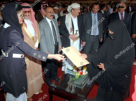 Saudi Prince Al-walid Bin Talal (2-l) Looks On As His Wife Princess Amira Al-tawil (l) Hands a Yemeni Woman (r) the Legal Documents of Her New House at the Al-walid Group-funded Resident Complex For the People Who Were Affected by a Landslide at Al-dhafeer Village in Sana'a Province Yemen 24 May 2009 in December 2005 About 120 People Died in a Landslide That Took Place in Al-dhafeer Village and 12 Houses Were Totally Destroyed