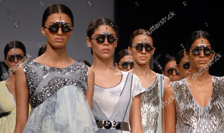 Models Take to the Catwalk As They Present Creations by Vivek Kumar at the 10th Annual Lakme India Fashion Week Spring/summer 2010 in Mumbai India 21 September 2009